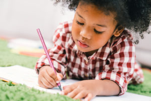 Child writing in a notebook
